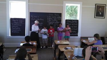 Students looking at typewriters