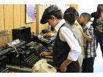 Student looking at old typewriter