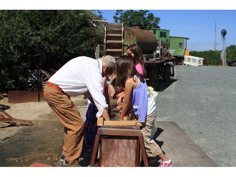Children panning for gold