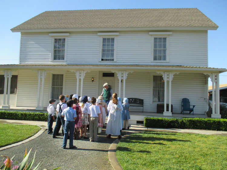 Students welcomed to Byer-Nail House by 'Mr. Byer'